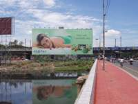 Giant ad at River Cooum (Anna Salai)